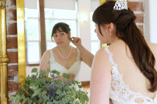 A stunning bride getting ready to walk the aisle! Her bouquet was different varieties of eucalyptus plus purple scottish thistle and fresh lavender!