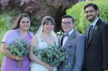 The happy couple and their maid of honor and best man, with greenery bouquets!