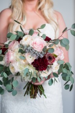 Lush and romantic, a stunning bridal bouquet in soft pinks, blush, creams, and deep burgundy red