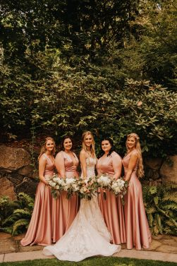 Bridesmaids bouquets in lush greenery and white flowers
