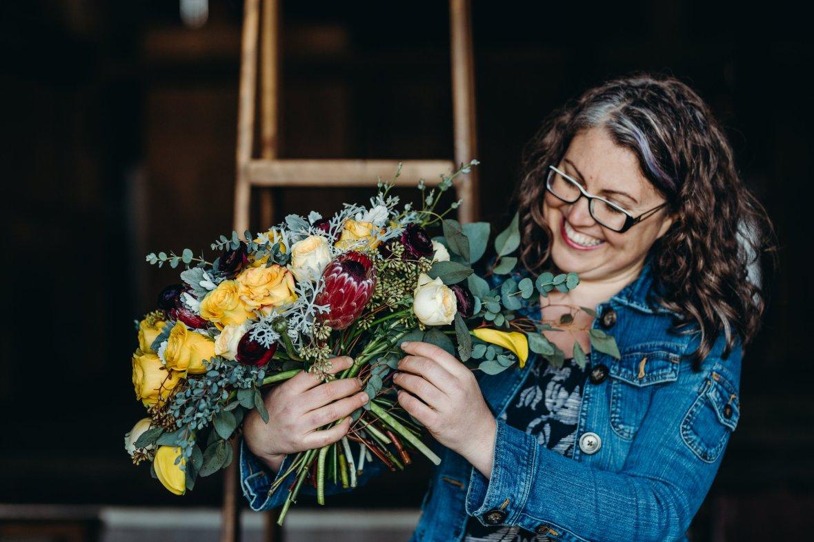 Alana designing a bride's bouquet