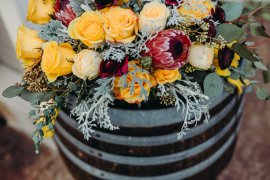 Rustic elegant and lush wine barrel arrangement