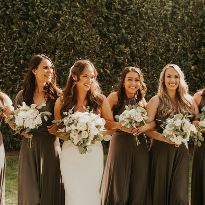 Romantic and classic style country club outdoor wedding. Bridal party florals in white, creams, and lush greenery