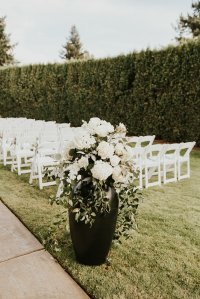 hydrangea, roses, stock flowers, southern smilax, smilax, urn arrangements, ceremony decor, classic wedding flowers