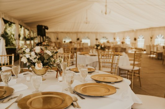 outdoor wedding tent, wedding tent decor, classic wedding centerpiece, romantic wedding centerpiece, vintage wedding centerpiece, reception tables, reception guest table decor, gold and white wedding, gold and ivory wedding, cream colored flowers