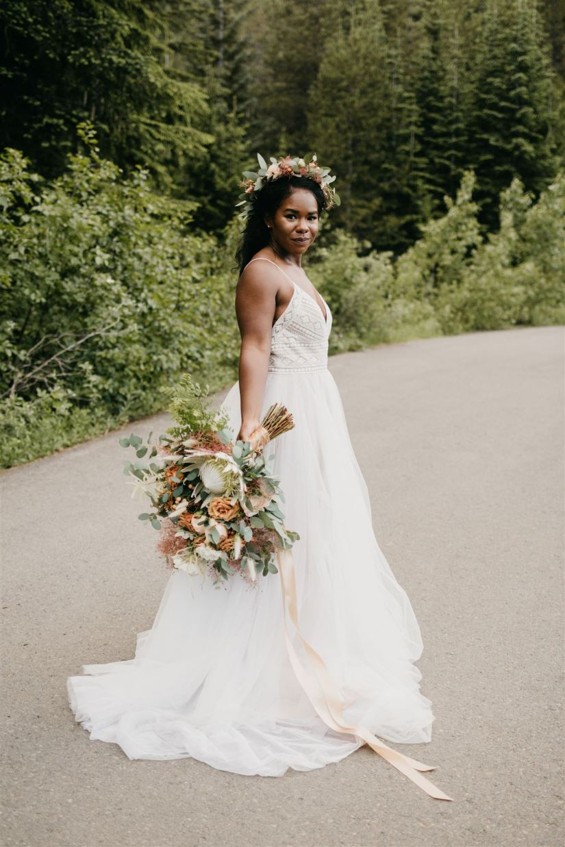black bride, black beauty, interracial couple, interracial wedding, boho bridal gown, boho flowers, boho bouquet