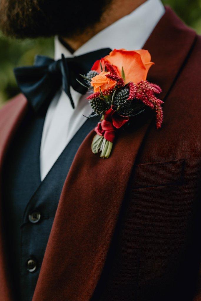 boutonniere, orange boutonniere, orange and burgundy boutonniere, jewel toned boutonniere, jewel toned wedding, jewel toned flowers, grooms suit, grooms attire, oregon wedding, oregon outdoor wedding, portland wedding, portland wedding florist, portland wedding flowers